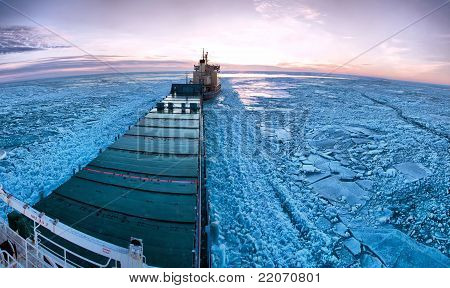 Icebreaker Towing Cargo Ship Through Thick Ice-field