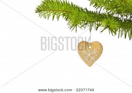Branch Of A Christmas Tree Decorated With Cookie