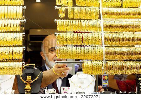 Golden bracelets on display