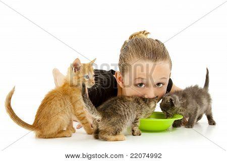 Adorable Girl Child Sharing Kitten's Milk Bowl