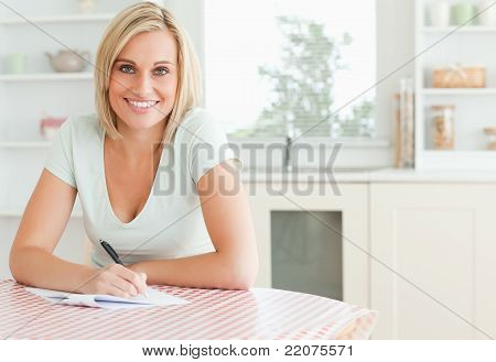 Charming Woman Proof-reading A Text Looks Into Camera