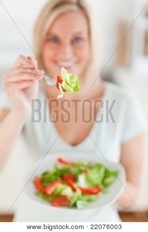 Smiling Woman Offering Salad
