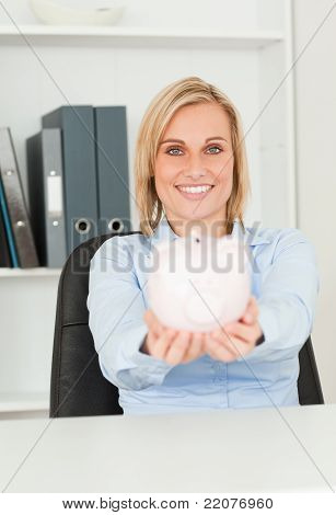 Cute Smiling Businesswoman Holding A Piggy Bank