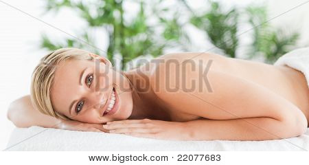 Good Looking Woman Relaxing On A Lounger