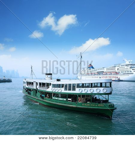 "HONG KONG - DECEMBER 14: Ferry ""Solar star"" leaves Kowloon pier on December 14, 2008 in Hong Kong, China. Ferry is in operation for over 120 years and is one main tourist attractions of the city."