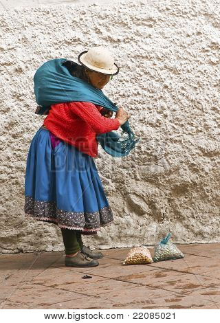 Indigenous Woman Carrying Goods