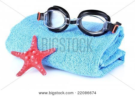 glasses for swimming and towel isolated on white