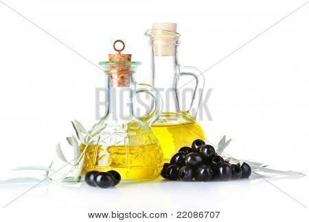 olive oil and olives isolated on white
