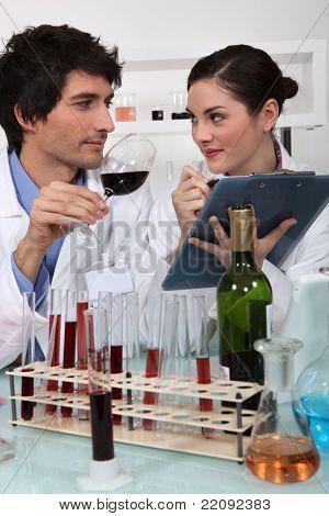 Oenologists analyzing a wine