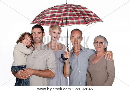 Family under umbrella