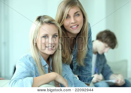 Three teenagers revising together at home