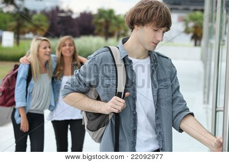 Three teenagers arriving at college