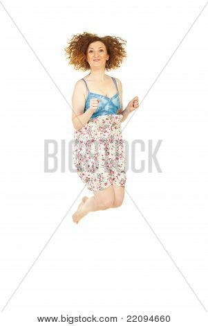 Happy Redhead Woman Jumping