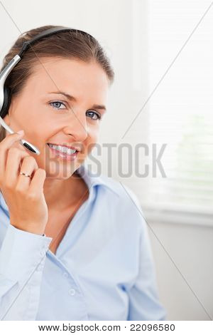 Woman Wearing Headphones Looking Into The Camera