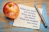 What you think, feel, imagine ... Buddha quote. Inspirational handwriting on a napkin with a fresh a poster