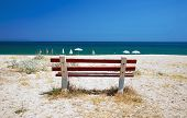 stock photo of nea  - One bench on the beach of Nea Vrasna Greece summer season - JPG