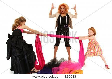 Two beautiful angry spoiled pageant girls fighting over fabric for dress design over white.