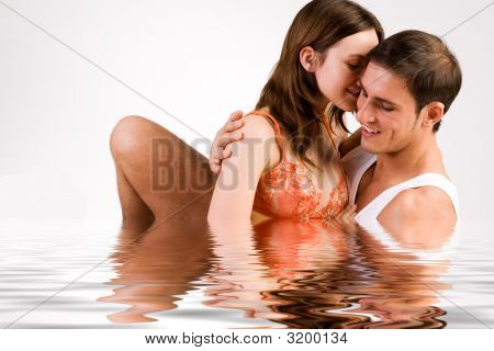 Sweet Young Couple Enjoying The Water