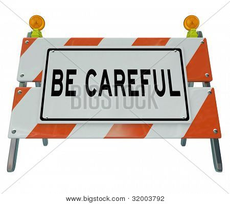 A road barricade with the words Be Careful urging you to use caution when entering a construction or work zone