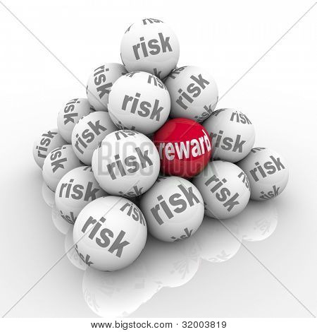 A pyramid of stacked balls each marked Risk with one reading Reward symbolizing the hidden benefits of taking a risk and overcoming a challenge with a great return on your investment of effort