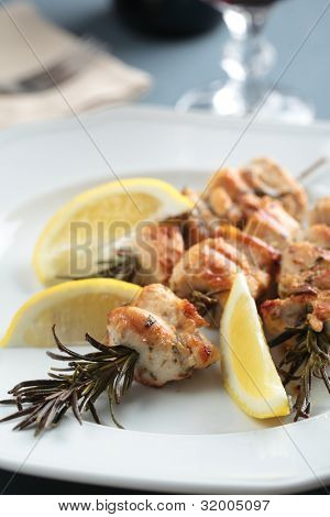 Chicken souvlaki on rosemary sticks with lemon