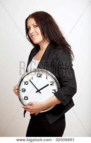 A Confident Woman Holding A Clock