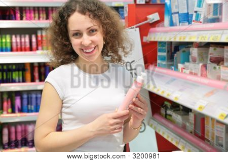 Young Woman In Cosmetic Shop