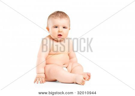 A 9 months old baby in diapers sitting isolated against white background