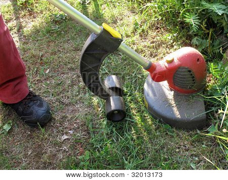 Person Using Grass Strimmer
