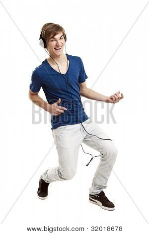 Portrait of a handsome young man dancing and listening music, isolated on white background