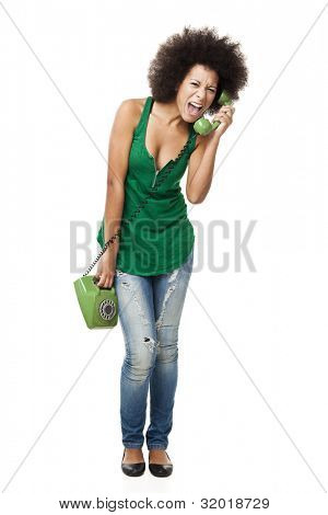 Afro-American young woman answering a call and yelling at phone, isolated on white background