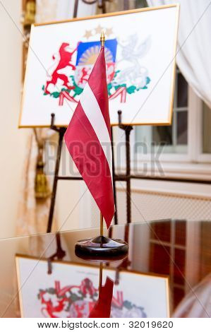 The National Flag And Coat Of Arms Of Latvia