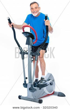 Senior Man Exercising On Stepper