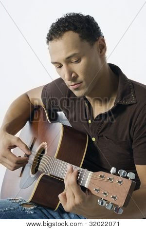 Young man strumming a guitar