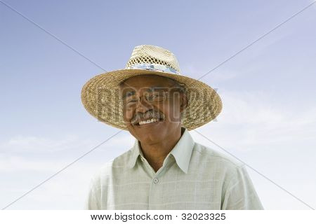 Portrait of senior African man wearing straw hat