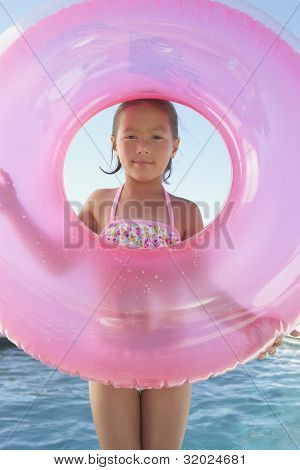 Young girl holding an inner tube