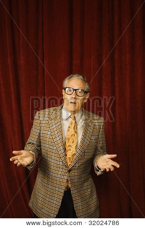Older man shrugging in geeky glasses