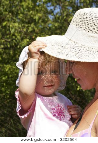 Girl And Her Grandmother In A Hat