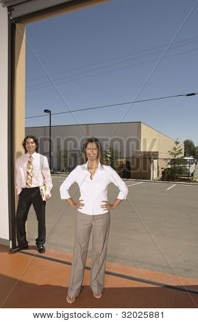 Businesswoman standing in a garage