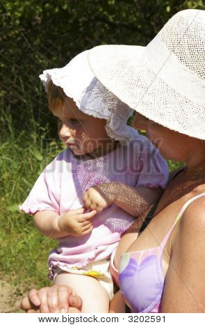 Grand Daughter And Grandmother In A Hat