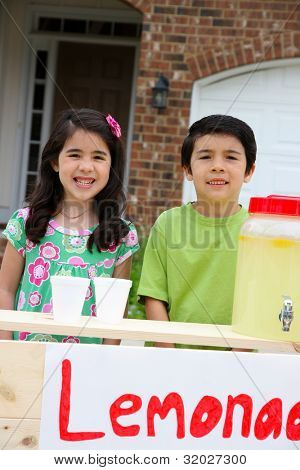 Children selling lemonade in front of their home