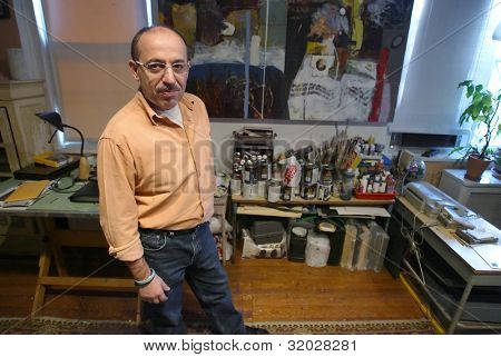 NEW YORK - OCTOBER 30: Artist Mikhail Gubin poses in his home studio on October 30, 2006 in Queens, NY.  Gubin is best know for his wood sculptures, paintings, collages and photo works.