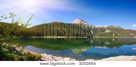 Panorama Of Mountain Lake With Reflections