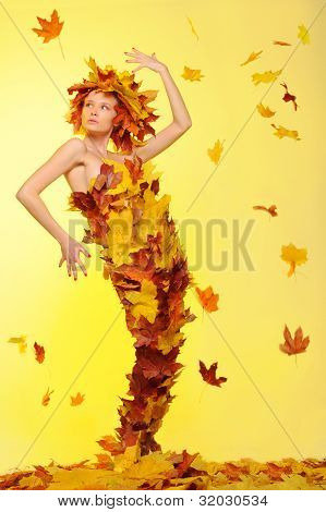 Woman In Dress Of Leaves And Defoliation
