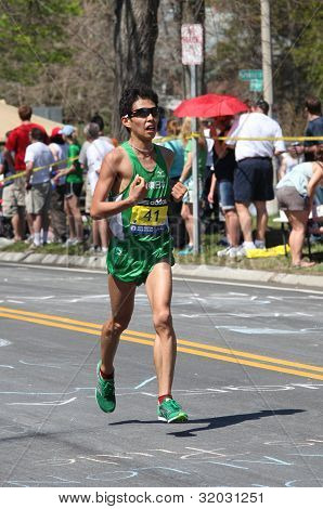 Tamura Hideaki (Japan) races up Heartbreak Hill during the Boston Marathon