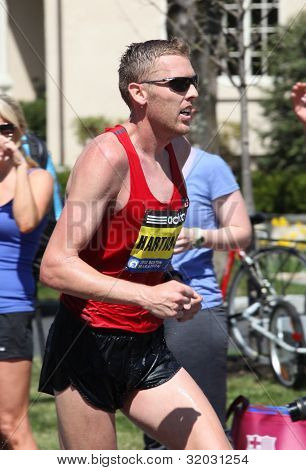 Jason Hartmann (Colorado) races up Heartbreak Hill during the Boston Marathon