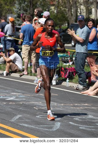 Jeptoo (Kenya) races up Heartbreak Hill during the Boston Marathon