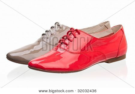 Patent leather women shoes against white