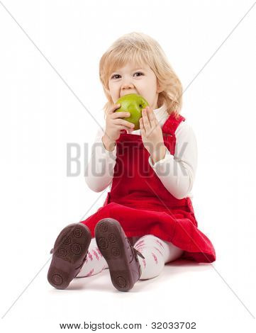 Baby girl eating apple. Isolated on white background