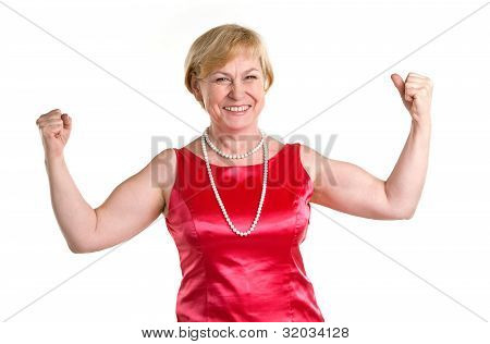 Portrait of fit senior woman flexing her biceps